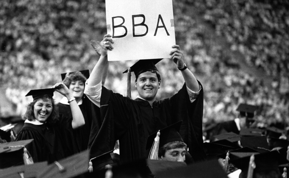 students cheering at BBA graduation ceremony